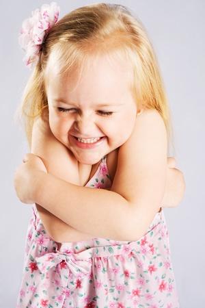blonde little girl: Cute expressive little girl