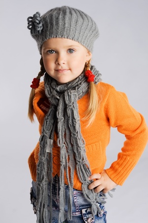 Little fashionable girl in warm clothes Stock Photo