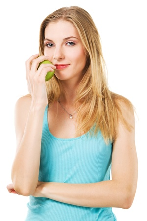Portrait of lovely girl with green apple against white background  photo