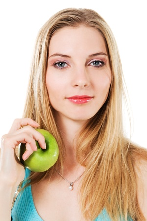 Lovely girl with green apple against white background  photo