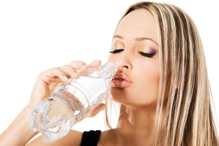 backround: Young beautiful woman drinking water, white background