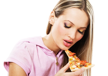 fastfood: Lovely young woman eating a pizza  Stock Photo
