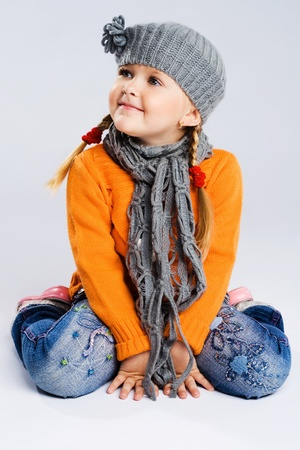 Cute fashionable girl in warm clothes