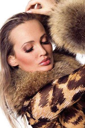 sexy fur: Portrait of a beautiful model in luxurious clothing Stock Photo