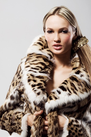 white coats: Portrait of a beautiful model in fur  Stock Photo
