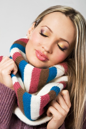 Portrait of a cute girl in warm comfort scarf  photo