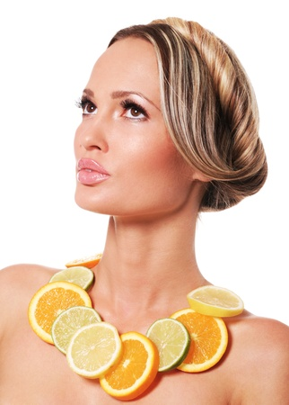 woman neck: Portrait of a beautiful woman with a fruit necklace  Stock Photo