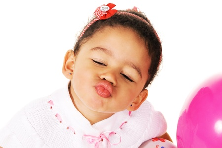 Pink lips: Cute little girl giving a kiss Stock Photo