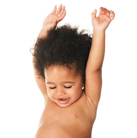 mulatto: Emotional little child against white background  Stock Photo