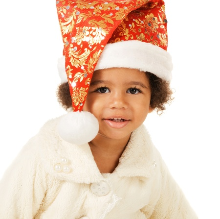 Portrait of a lovely baby in Christmas hat and fur on white background  photo