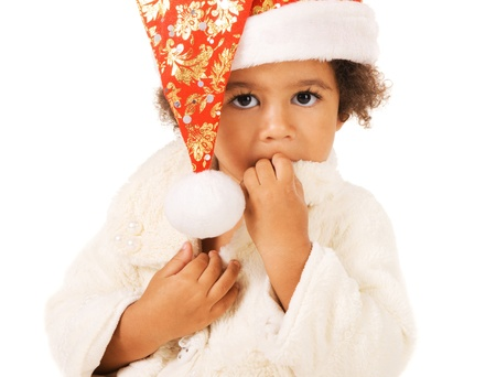 Portrait of a cute baby in Christmas hat and fur on white background Stock Photo - 11204035