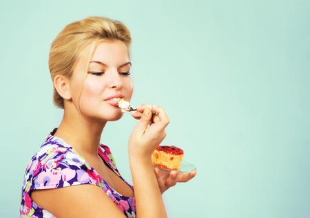 eating pastry: Pretty blonde eating fruit cake