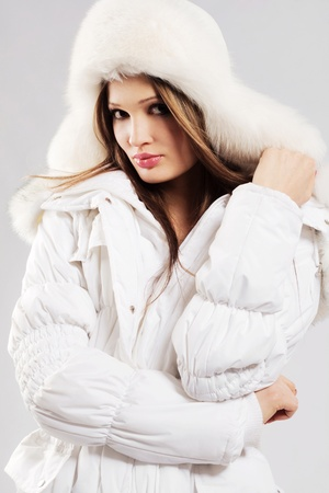 Beautiful woman in white winter clothing photo