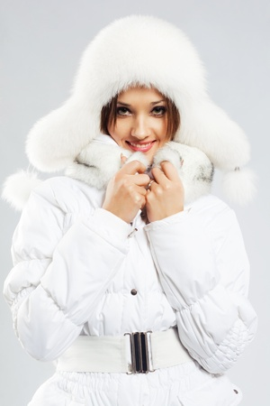 padded: Lovely woman in white winter clothing