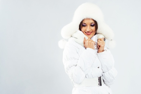Lovely woman in white winter clothing photo