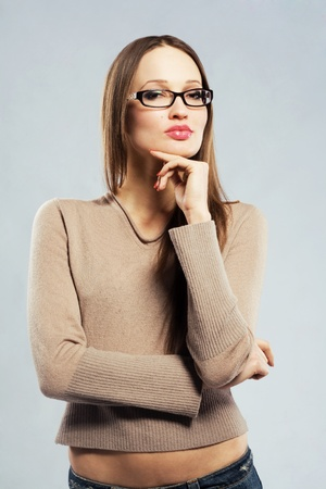 Young serious woman in spectacles photo