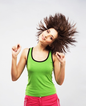 Lovely woman having fun with shaking her hair photo