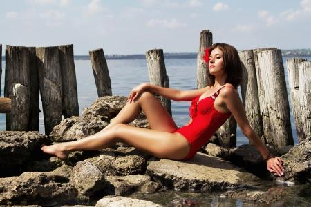 hot legs: Beautiful woman getting a tan near the water
