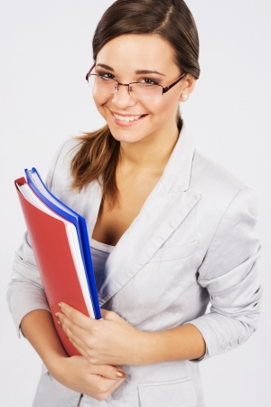 Portrait of a lovely young businesswoman with folders and documents  photo