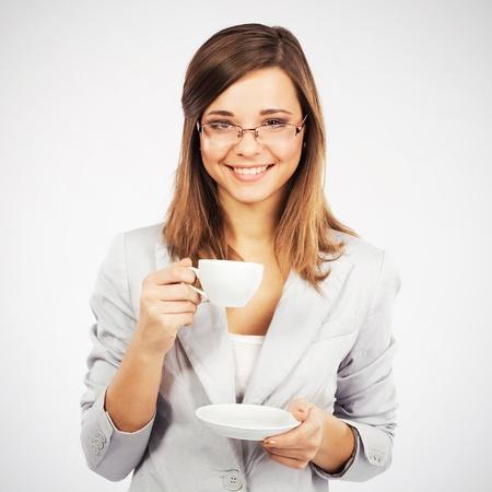 coffeebreak: Young cheerful businesswoman having a coffee-break