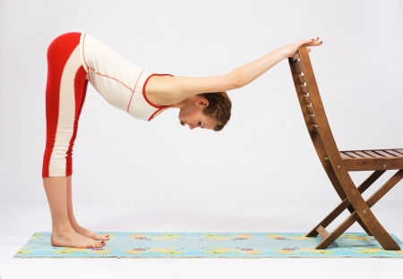 stretches: Beautiful sporty woman doing stretching exercise