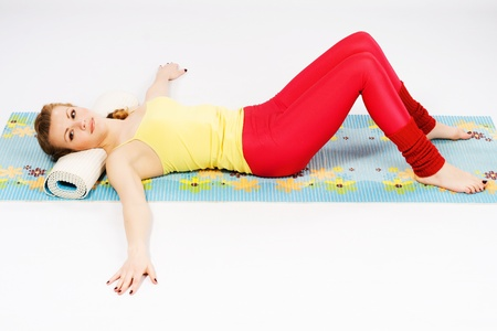 Beautiful sporty woman doing stretching exercise  photo