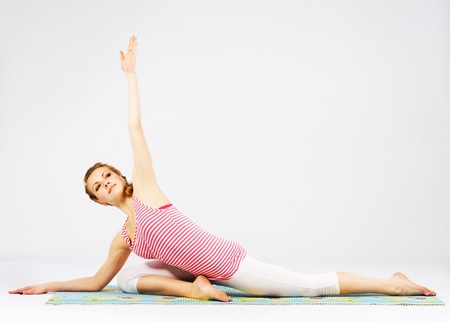 Beautiful sporty woman doing stretching exercise