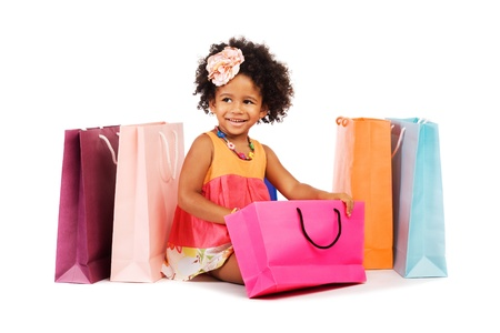 Lovely little girl with shopping bags photo