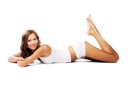 Beautiful woman with perfect figure is lying on white background Stock Photo
