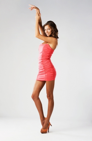 Gorgeous woman in pink dress photo