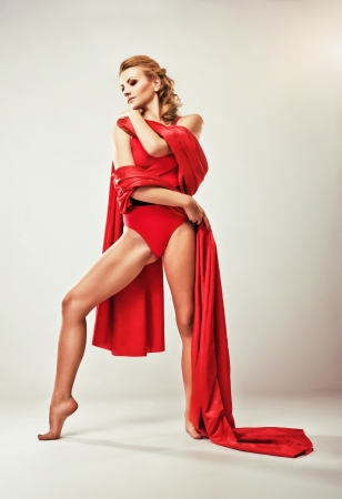 Portrait of gorgeous model in red clothing  photo