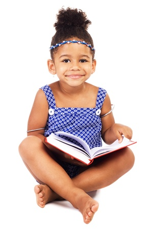 Lovely little girl with notebook sitting on white background
