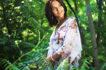 Beautiful woman in tropical forest