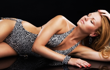 bangle: Studio portrait of gorgeous model on black background