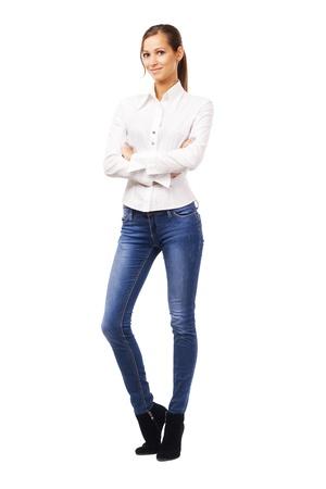 blusa: Hermosa mujer con camisa blanca y jean azul, aislados en blanco Foto de archivo