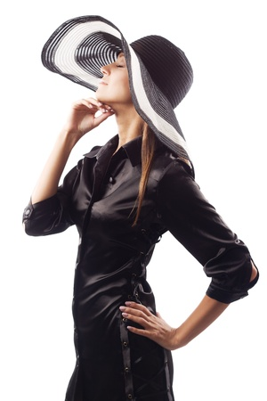 black satin: Beautiful model in black satin dress and big sunhat against white background