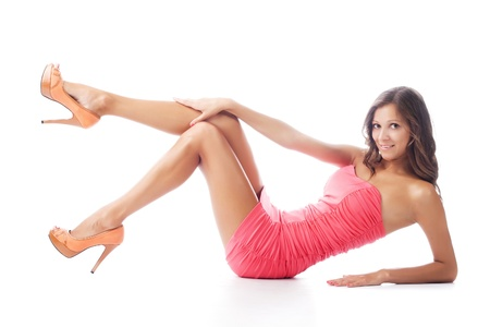 Beautiful happy woman in pink gown