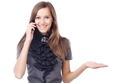 imaginary dialogue: Hermosa mujer hablando por tel�fono m�vil y la celebraci�n de algo imaginario