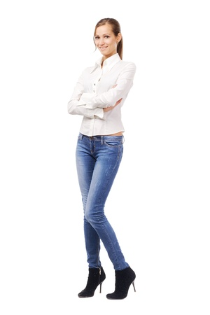 women jeans: Lovely woman in white shirt and blue jeans, isolated on white  Stock Photo
