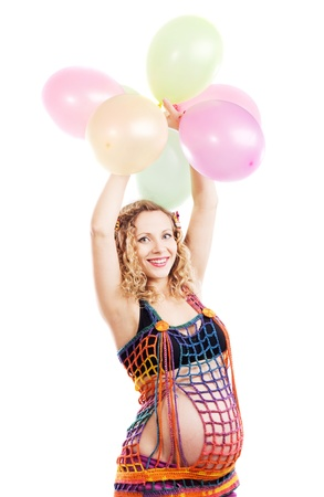 Happy beautiful pregnant woman with colorful balloons against white Stock Photo