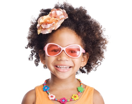 Portrait of beautiful happy little girl in sunglasses