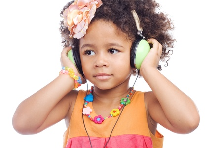 Cute little girl in big headphones against white background