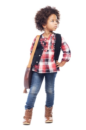 Beautiful stylish little girl with leather bag against white background photo