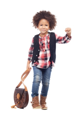 Beautiful stylish little girl with leather bag against white background