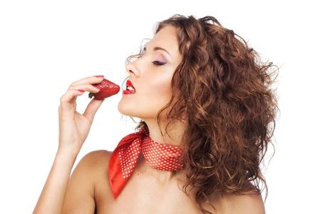 kerchief: Beautiful seductive woman eating a strawberry Stock Photo