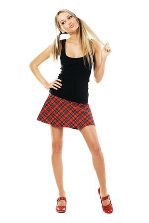 falda corta: Mujer encantadora joven contra el fondo blanco