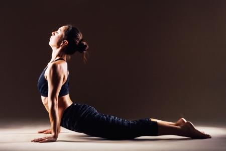 bhujangasana: Beautiful sporty woman is working out. Cobra Pose. Bhujangasana. Stock Photo