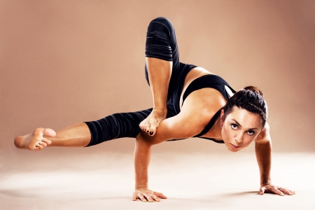 yoga pose: Beautiful sporty woman is working out Stock Photo