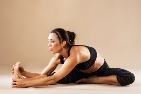 yoga studio: Beautiful sporty woman is working out Stock Photo