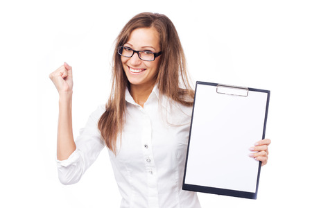 Lovely cheerful businesswoman with clipboard against white background  Stock Photo - 23875318